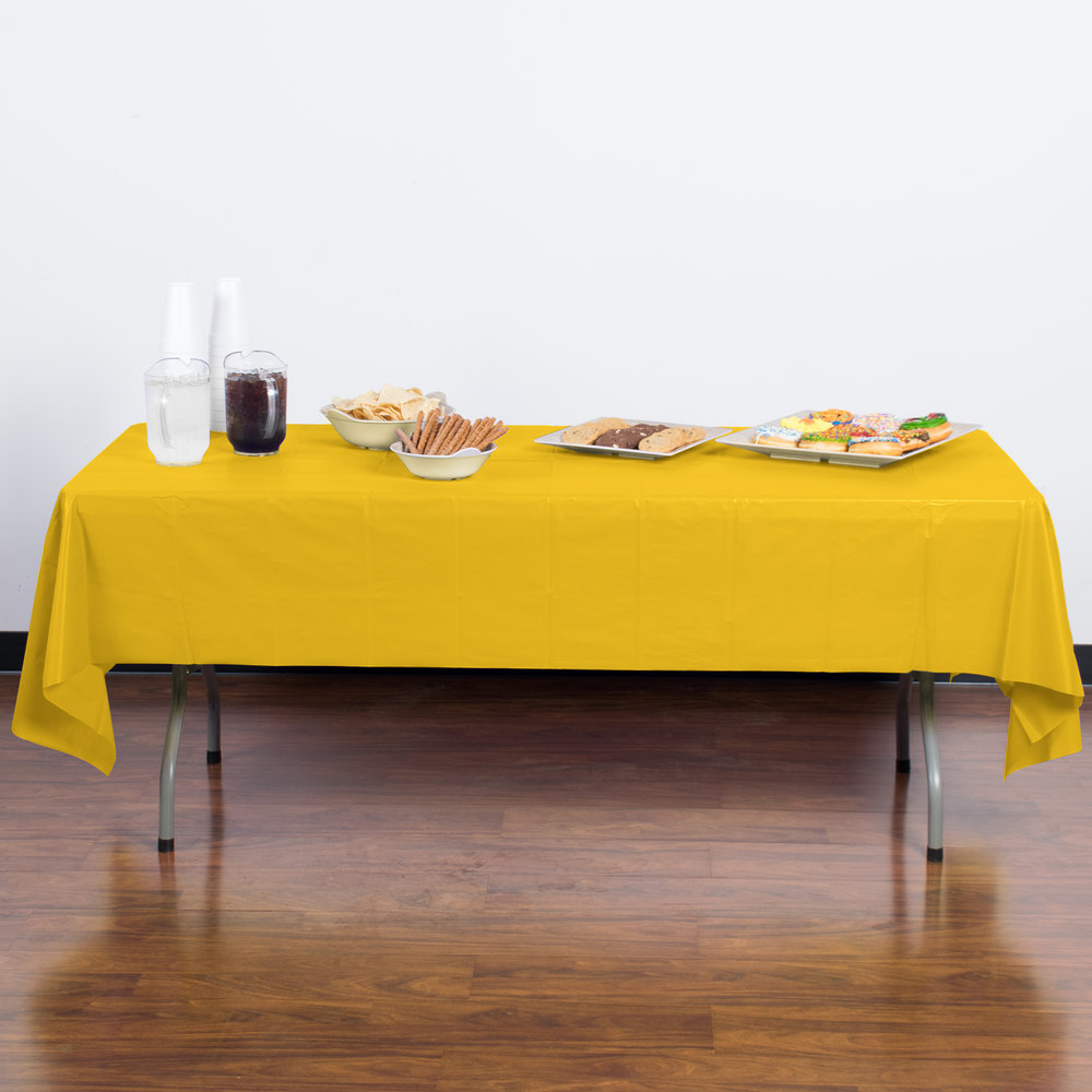 "Creative Converting 011012B 54"" x 108"" School Bus Yellow Disposable Plastic Table Cover - 24/Case"