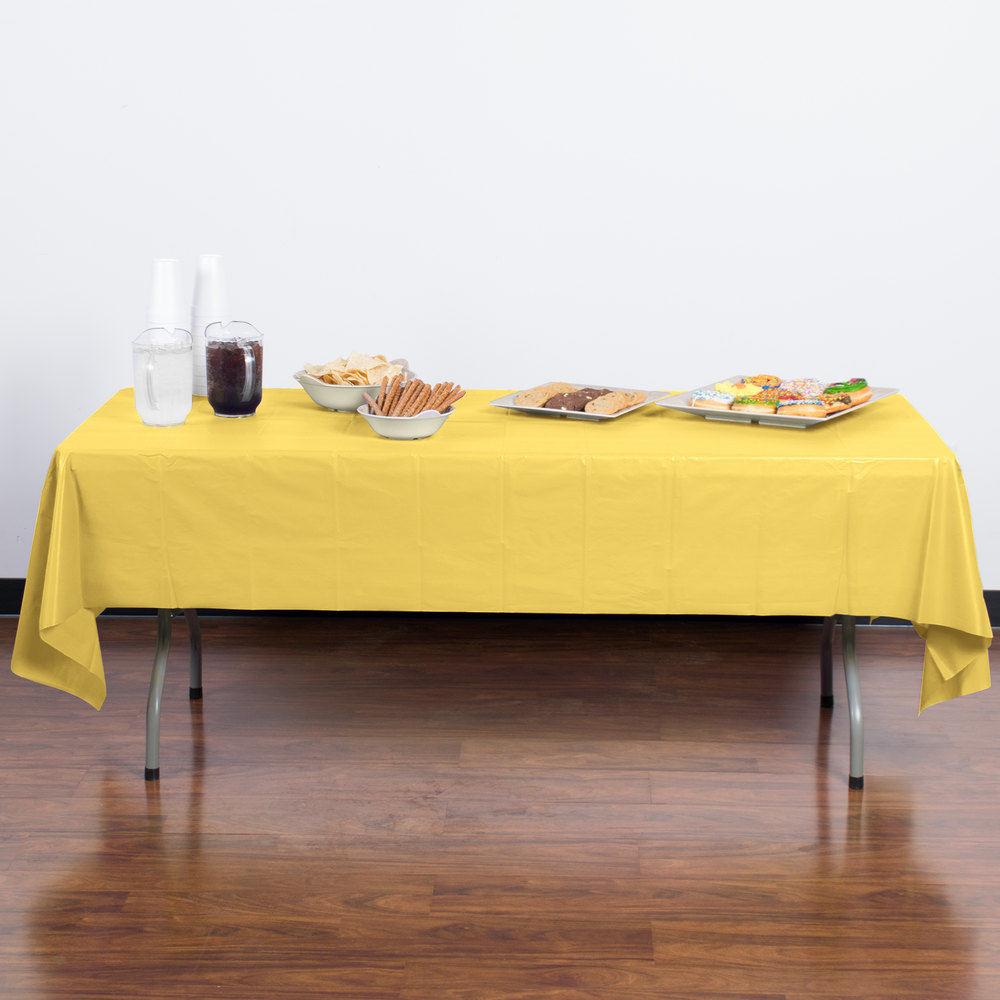 "Creative Converting 1252 108"" x 54"" Mimosa Yellow Disposable Plastic Table Cover - 12/Case"