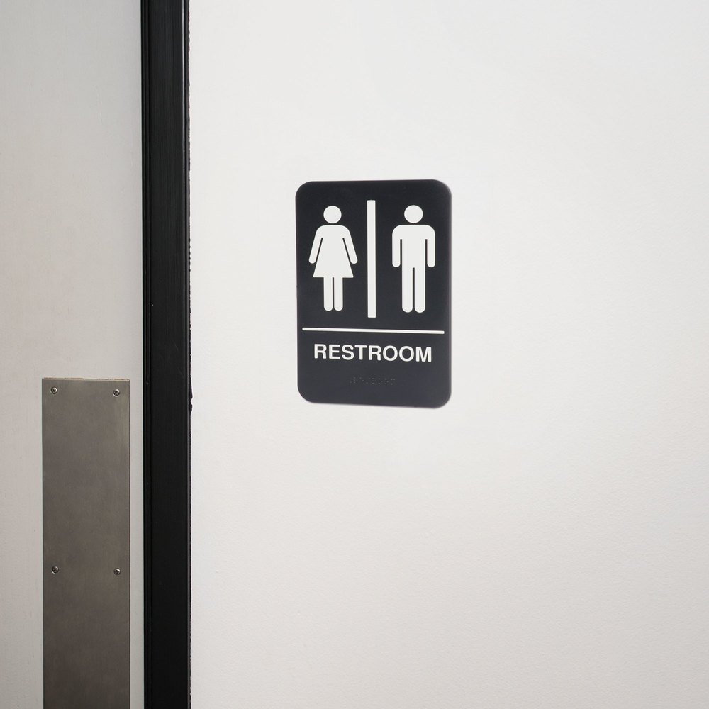 black and white unisex restroom sign with braille 9 x 6