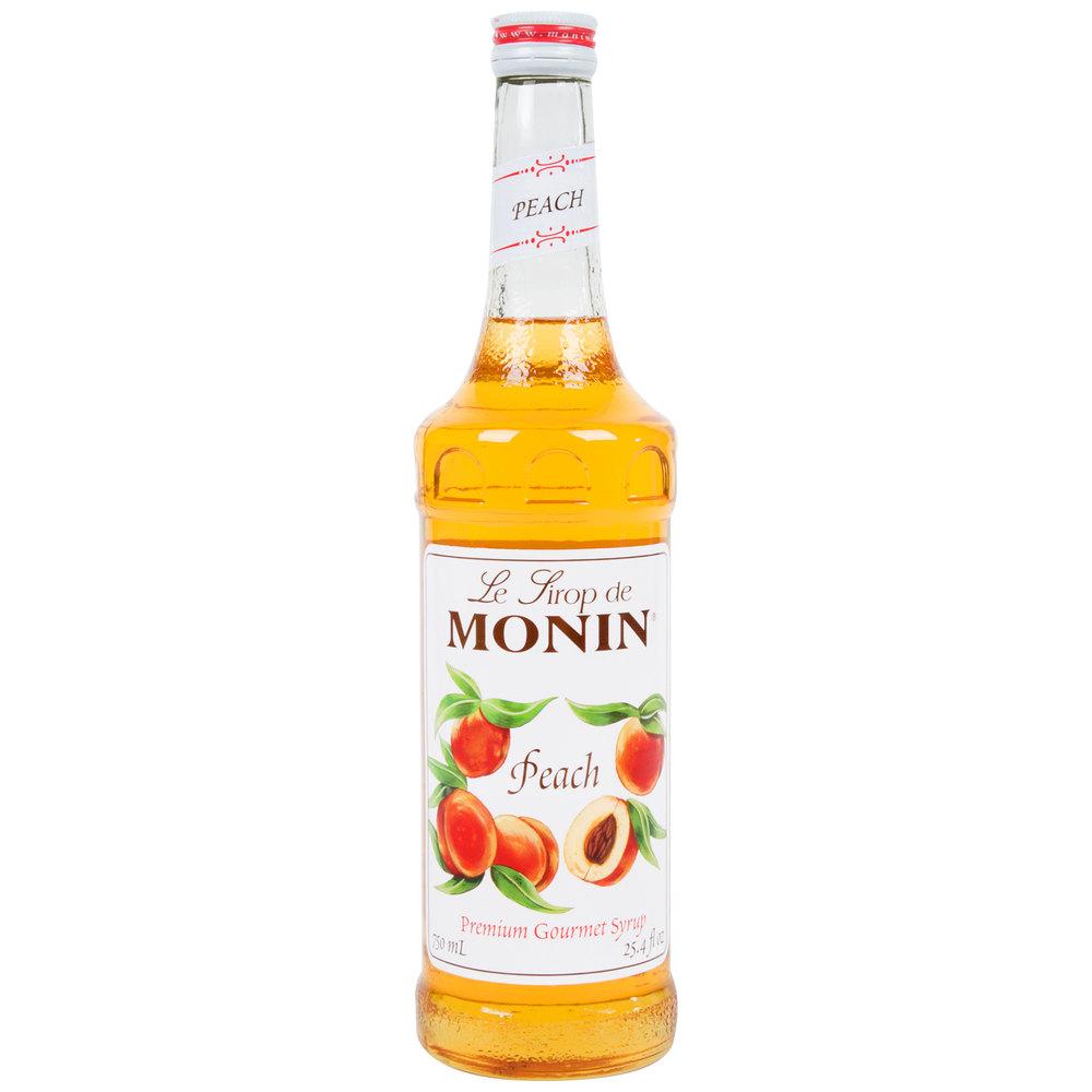 Monin 750 mL Premium Peach Flavoring / Fruit Syrup