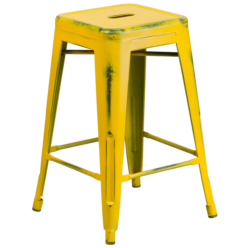 Distressed Yellow Stackable Metal Counter Height Stool with Drain Hole ...