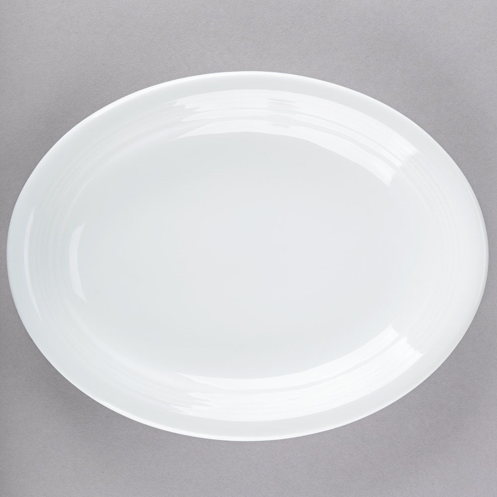 "Tuxton CWH-1142 Concentrix 11 1/2"" x 8 3/4"" White Oval China Coupe Platter - 12/Case"