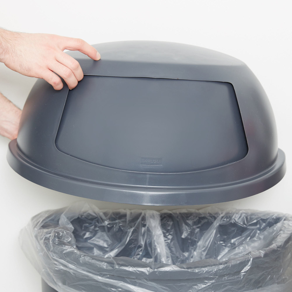 Free swinging lid round waste receptacle