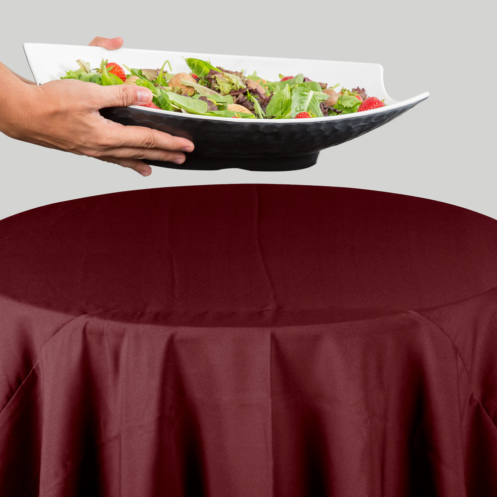 "120"" Round Burgundy 100% Polyester Hemmed Cloth Table Cover"