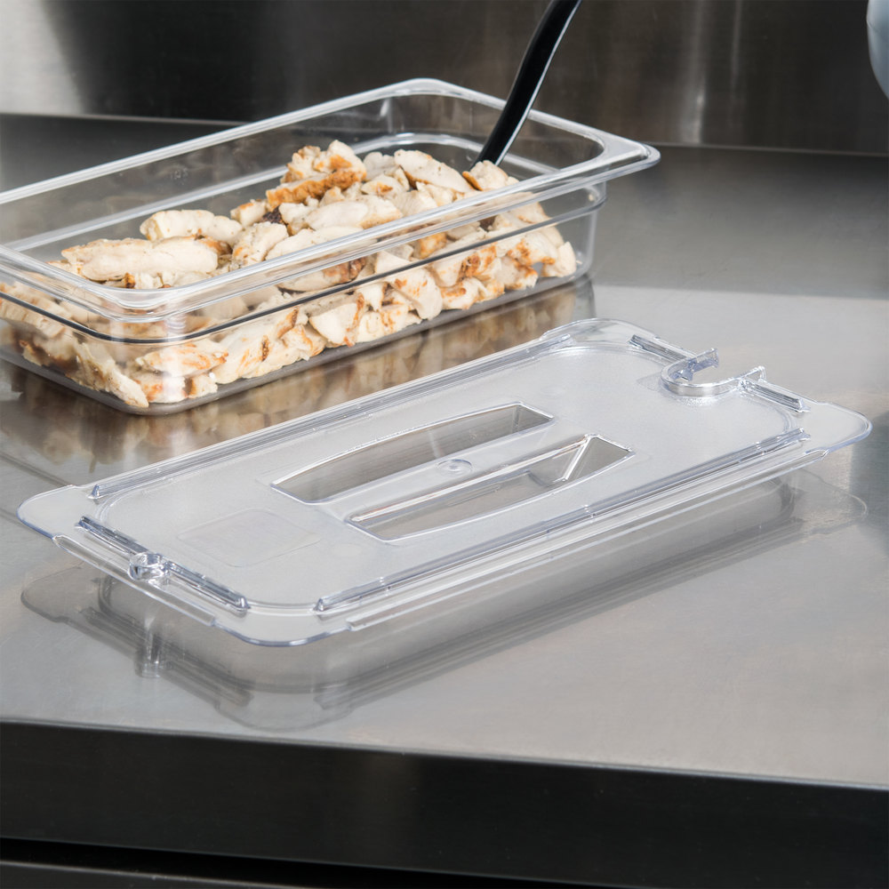 Carlisle 10271U07 StorPlus 1/3 Size Clear Universal Handled Lid with Spoon Notch