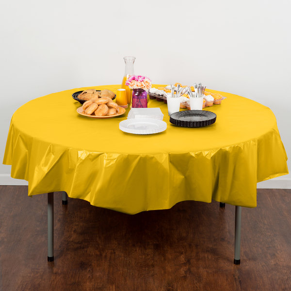 "Creative Converting 703269 82"" School Bus Yellow OctyRound Disposable Plastic Table Cover - 12/Case"