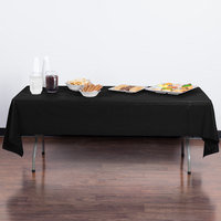 Creative Converting 01290B 54 inch x 108 inch Black Velvet Disposable Plastic Table Cover - 24/Case