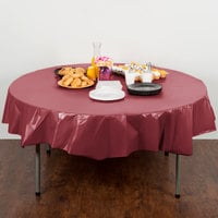Creative Converting 703122 82 inch Burgundy OctyRound Disposable Plastic Table Cover - 12/Case