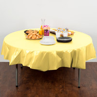 Creative Converting 703266 82 inch Mimosa Yellow OctyRound Disposable Plastic Table Cover - 12/Case