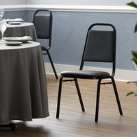 Lancaster Table & Seating Black Stackable Banquet Chair with 1 inch Padded Seat
