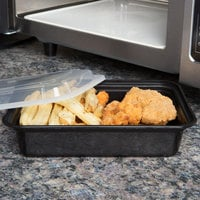 Pactiv Newspring NC888B 38 oz. Black 6 inch x 8 1/2 inch x 2 inch VERSAtainer Rectangular Microwavable Container with Lid - 150/Case