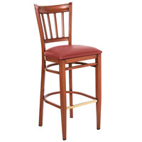 Lancaster Table & Seating Spartan Series Bar Height Metal Slat Back Chair with Mahogany Wood Grain Finish and Red Vinyl Seat - Detached Seat