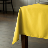 Intedge 54 inch x 120 inch Rectangular Yellow 100% Polyester Hemmed Cloth Table Cover