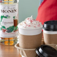 Monin 750 mL Premium Peppermint Flavoring Syrup