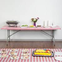 Creative Converting 37388 Stay Put Red Gingham 30 inch x 96 inch Rectangular Plastic Tablecloth with Elastic - 12/Case