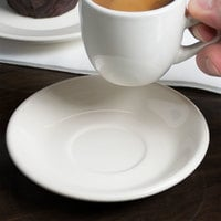 Choice 4 7/8 inch Ivory (American White) Rolled Edge Stoneware Saucer - 36/Case