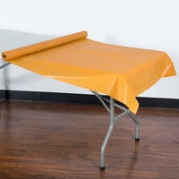 Creative Converting 323377 100' Pumpkin Spice Orange Disposable Plastic Tablecover