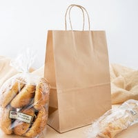 Small 9 5/8 inch x 5 1/4 inch x 13 3/8 inch Natural Kraft Shopping Bag with Handles - 250/Bundle