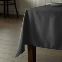 Intedge 54 inch x 110 inch Rectangular Black 100% Polyester Hemmed Cloth Table Cover
