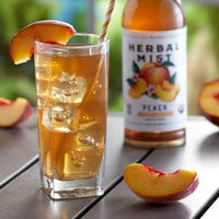 Herbal Mist 16.9 fl. oz. Sweetened Peach Iced Tea with Yerba Mate - 12/Case