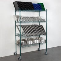 Regency 24 inch x 48 inch Green Epoxy Drying Rack 4-Shelf Kit with 64 inch Posts and Casters - 1 1/4 inch Slots