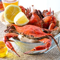 Linton's 5 1/4 inch Non-Seasoned Steamed Medium Maryland Blue Crabs - 12/Case