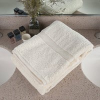Oxford Vicenza Avorio 30 inch x 58 inch 100% Ringspun Combed Cotton Bath Towel with Dobby Border 20 lb. - 12/Pack