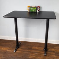 Lancaster Table & Seating Bar Height Table with 30 inch x 42 inch Reversible Cherry / Black Table Top and Straight Base Plates