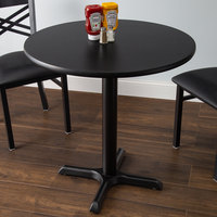 Lancaster Table & Seating Standard Height Table with 30 inch Round Reversible Cherry / Black Table Top and Cross Base Plate
