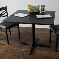 Lancaster Table & Seating Standard Height Table with 36 inch x 36 inch Reversible Cherry / Black Table Top and Cross Base Plate