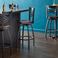 Lancaster Table & Seating Cross Back Bar Height Black Swivel Chair with Mahogany Wood Seat
