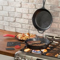Lodge 7-Piece Essential Pre-Seasoned Cast Iron Skillet Set - Includes 10 1/4 inch Skillet, 10 1/4 inch Grill Pan, 10 1/2 inch Griddle, Silicone Handle Holder, Silicone Trivet, and Two Pan Scrapers