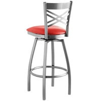 Lancaster Table & Seating Clear Coat Steel Cross Back Bar Height Swivel Chair with 2 1/2 inch Red Vinyl Seat