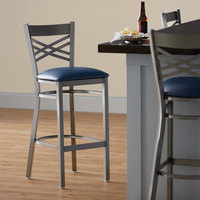 Lancaster Table & Seating Clear Coat Steel Cross Back Bar Height Chair with 2 1/2 inch Navy Vinyl Seat - Detached Seat