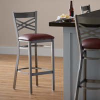 Lancaster Table & Seating Clear Coat Steel Cross Back Bar Height Chair with 2 1/2 inch Burgundy Vinyl Seat - Detached Seat