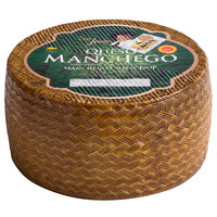 Don Juan 3.5 lb. 4-Month Aged Queso Manchego DOP Cheese Wheel - 4/Case