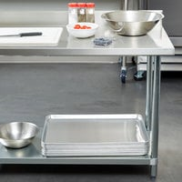 Regency 30 inch x 72 inch 18-Gauge 304 Stainless Steel Commercial Work Table with 4 inch Backsplash and Galvanized Undershelf