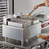 Cooking Performance Group F302 30 lb. Dual Tank Heavy-Duty Electric Countertop Fryer - 208/240V, 8400/11,000W