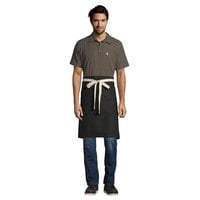 Uncommon Threads 3117 Black Customizable 100% Cotton Canvas Moxie Waist Apron with Natural Webbing and 3 Pockets - 24 inchL x 34 inchW
