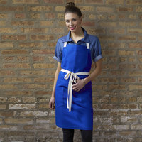 Uncommon Threads 3115 Deep Royal Customizable 100% Cotton Canvas Vibe Bib Apron with Natural Webbing and 3 Pockets - 34 inchL x 36 inchW