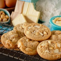 Rich's 1.5 oz. Everyday Preformed White Chocolate Chip Macadamia Nut Cookie Dough - 210/Case