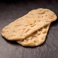 Rich's 12 inch x 5 inch Par-Baked Oval Flatbread Crust - 48/Case