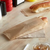 Carnival King 3 1/2 inch x 1 1/2 inch x 9 inch Plain Kraft Paper Hot Dog Bag - 1000/Case