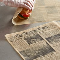 Choice 16 inch x 12 inch Kraft Newspaper Print Deli Sandwich Wrap Paper - 500/Pack