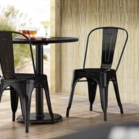 Lancaster Table & Seating Alloy Series Black Metal Indoor / Outdoor Industrial Cafe Chair with Vertical Slat Back and Drain Hole Seat