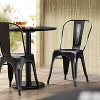 Lancaster Table & Seating Alloy Series Distressed Black Metal Indoor / Outdoor Industrial Cafe Chair with Vertical Slat Back and Drain Hole Seat