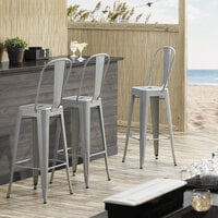 Lancaster Table & Seating Alloy Series Silver Metal Indoor / Outdoor Industrial Cafe Barstool with Vertical Slat Back and Drain Hole Seat