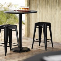 Lancaster Table & Seating Alloy Series Black Stackable Metal Indoor / Outdoor Industrial Cafe Counter Height Stool with Drain Hole Seat