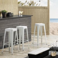 Lancaster Table & Seating Alloy Series White Stackable Metal Indoor / Outdoor Industrial Barstool with Drain Hole Seat