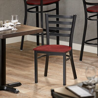Lancaster Table & Seating Black Finish Metal Ladder Back Cafe Chair with Mahogany Wood Seat - Detached Seat
